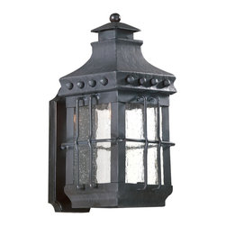 "Troy - Dover Collection 15 1/4"" High Outdoor Wall Light - The Dover outdoor collection from Troy Lighting is crafted from hand-forged iron. A hand-crafted vibe and influence from centuries past shine through in this glorious design. The frame is presented in a natural bronze finish. Panes of clear seeded glass gracefully display the glowing fixtures within. A wonderful design for lighting your outdoor spaces. Hand-forged iron construction. Natural bronze finish. Clear seeded glass. Takes one 100 watt bulb (not included). 15 1/4"" high. 6 3/4"" wide. Extends 8 1/2"" from the wall. 8 3/4"" from mounting point to top.  Hand-forged iron construction.   Natural bronze finish.   Clear seeded glass.   Takes one 100 watt bulb (not included).   15 1/4"" high.   6 3/4"" wide.   Extends 8 1/2"" from the wall.   8 3/4"" from mounting point to top."