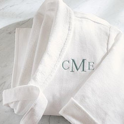 Organic Cotton Spa Robe, Large, White - Wrap up in the comfort and purity of pure organic cotton. Our spa robe brings the luxury of a world-class spa into the comfort of your own home. 300-gram weight. Waffle texture is pique woven of 100% organic cotton. Lined with double-twisted terry loops. Features a full shawl collar, turned-back cuffs, 2 patch pockets and a loop for hanging robe. Double-sided loops hold self-tying sash. Monogramming is available at an additional charge. Monogram will be placed on the upper left-side of the robe. Machine washable. Unisex sizes S, M, L or XL. Made in Turkey.