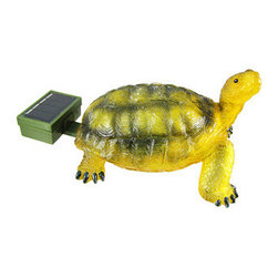 Terry The Turtle Solar Light Statue Flickering LED - Call Of The Wild outdoor statues are a collection of wildlife figures that decorate your garden day and night. Terry, the Solar Turtle, will look great in your garden, on your patio or on your doorstep. Terry is solar powered, and a clear LED in the bottom turns on automatically in dark conditions, making his body glow warmly, lasting up to 10 hours under a full charge. Made of cold cast resin, Terry measures 4 inches tall, 5 inches wide and 8 inches deep. He`s hand-painted, and shows great detail, so he looks great during the day, too!.