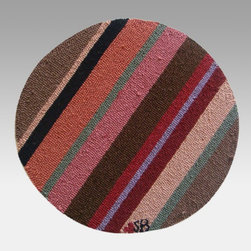 Susan Branch - Susan Branch Yipes! Stripes! 15 in. Round Chair Pad - SB-0040 - Shop for Rugs and Runners from Hayneedle.com! Make your next meal a little more lively! The Susan Branch Yipes! Stripes! Chair Pad is ideal for cafes and seating nooks with bright swipes of brown pink and sage for a fresh modern look. This 15-inch round chair pad is hand-hooked from 100% wool at 90 lines per square foot for a dense comfy texture. Monk's cloth a heavy basket-weave cotton provides a backing that's both durable and luxurious. This chair pad comes complete with easy cleaning instructions and is designed for indoor use in residential or commercial settings.About Thorndike MillsRooted in a proud Armenian family tradition Thorndike Mills developed in Boston during the first half of the 20th century. Their dedication to the quality traditions of Armenian rug-making remains true today. With an emphasis on exact specifications materials that meet high levels of quality and rigorous construction standards they're a top producer of braided rugs for homes and businesses across America. Thorndike Mills is the only manufacturer who still produces true cloth braided rugs made with three strands woven together and then wrapped; the next best option would be a handmade rug. The true quality of the rugs lies in the little details like hidden joints guaranteed color matching perfect symmetry of design and durable lock-stitch sewing. Thorndike Mills is still owned today by the third generation of the founding family.About Susan BranchSusan Branch is a self-taught artist from the Martha's Vineyard area who creates delicate organically inspired works that celebrate nature and simplicity. She has previously been featured in magazines including Country Living and American Patchwork and Quilting. Susan is best known for her beautiful watercolor illustration work which graces her 14 published books as well as a line of china stationery pajamas and her popular yearly calendar.