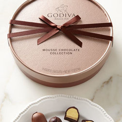 Godiva - Godiva 18-Piece NM Exclusive Mousse Collection Chocolates - Experience the complex flavors of these ganache fillings paired perfectly with dense shells of milk or dark chocolate and fall in love all over again. Enlightened indulgence! Assortment includes five sensuous flavors: smooth milk chocolate, refreshing....