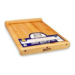 """John Boos - Reversible Cutting Board Multicolor - KNEB17 - Shop for Cutting Boards from Hayneedle.com! The Boos Block Reversible Countertop Board is ideal for food preparation. This versatile reversible board can be used as a countertop or as a serving tray. It is constructed from hard maple with a natural oil finish. This 1.25-inch-thick board comes with a choice of size and is easy to handle with its hand grips. It has a one-year warranty.John Boos & Co. has been in business continuously since 1887. John Boos & Co. is the number one supplier of butcher blocks countertops and cutting boards to restaurants butchers and even the White House. They are used by celebrity chefs throughout the United States. In addition the country's premier food channel """"The Food Network """" features chefs such as Mario Batali and Emeril Lagasse who prepare meals every day on John Boos cutting boards. In most cases Boos cutting boards are used on the daily and weekly television programs sponsored for the chefs. Plus John Boos & Co. has been awarded the Gold Medal for Excellence in Foodservice Equipment by the Chefs of America."""