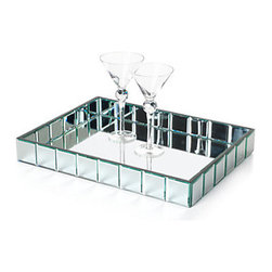 Z Gallerie - Mirage Tray - Rectangle - For the most glamorous evenings, serve your lively libations on Z Galleries exclusive Mirage mirrored tray. The flat mirror base is rimmed with an edge of beveled mirror squares, inside and out, to carry cocktails with flair. Black fabric underneath the tray ensures tabletop protection. Measures 19.5 x 14.5 x 2.5.