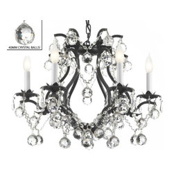 "The Gallery - BLACK WROUGHT IRON CRYSTAL CHANDELIER LIGHTING H 19"" W 20"" DRESSED WITH FENG ... - BLACK WROUGHT IRON CRYSTAL CHANDELIER LIGHTING. H 19"" W 20"" DRESSED WITH FENG SHUI 40MM CRYSTAL BALLS! A Great European Tradition. Nothing is quite as elegant as the fine crystal chandeliers that gave sparkle to brilliant evenings at palaces and manor houses across Europe. This beautifully unique version from the Maria Theresa Collection has 100% Crystals that capture and brilliantly reflect the light of the candle bulbs which sit in a leaf design bobache. The frame is all wrought iron, adding the finishing touch to a wonderful fixture. The timeless elegance of this chandelier is sure to lend a special atmosphere anywhere its placed! SIZE: H.19"" W.20"" 6 LIGHTS. Assembly Required."