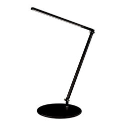 "Koncept - Koncept Gen 3 Z-Bar Solo Mini Warm Light LED Black Desk Lamp - The black Gen 3 Z-Bar Solo Mini modern LED desk light is a compact design with a single arm and an LED head that can fold flat against the body. It produces 40% more light than Gen 2 models and features improved design and adjustability. A convenient control strip allows one touch on/off and LED dimmer operations. The energy efficient LEDs produce a warm light that will last for up to 50000 hours. Five year manufacturer's warranty. This energy saving light earns LEED credits. Aluminum construction. Black finish. One touch dimming and on/off. 9' black power cord. Includes 28 LEDs with 7 watts total energy consumption. 3200-3700K color temperature warm light; CRI 85. LED lifespan up to 50000 hours. Adjustable positions; maximum extension is 29"" high. Round base is 7 1/2"" wide.  Aluminum construction.   Black finish.   One touch dimming and on/off.  Includes 28 LEDs with 7 watts total energy consumption.  3200-3700K color temperature warm light; CRI 85.   LED lifespan up to 50000 hours.   Earns LEED credits.  15"" column height plus 14"" adjustable arm.  7 1/2"" diameter weighted base.  9' black power cord.   5 year manufacturer's limited warranty."