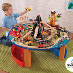 KidKraft - Kids Toy Train Kidkraft Dino Train Set and Table From Vistastores - This 95-piece Huge Dinosaur Train Set & Table is perfect gift for your little kids. Young boys and girls will love to push this train car in and out of the lava-filled volcano and through the tunnel made of dinosaur bones. It has 95-piece train set and Long winding track. This Train cars can pass through the plastic molded volcano from 6 different angles. It also has Five smiling cavemen and cavewomen , Prehistoric police station and fire station with plastic molded roofs, Moving dinosaur crane lifts and lowers heavy logs, Three train cars, an airplane, a helicopter and 4 other vehicles.