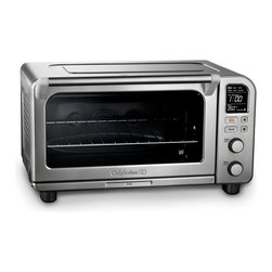 "Calphalon XL Digital Convection Oven - The Calphalon XL Digital Convection Oven provides the ultimate flexibility in a toaster oven, while still fitting on your countertop. Cook a wide variety of dishes with the bake, convection bake, broil and toast settings, plus presets for bagels, pizza and cookies. The high-contrast digital LCD screen is easy to read. The interior is spacious enough for a 9"" x 13"" pan or a 12"" pizza! Calphalons exclusive Opti-Heat System ensures accurate temperature control and even heat delivery. The front access crumb tray and high performance bronze nonstick interior coating makes cleaning quick and easy."