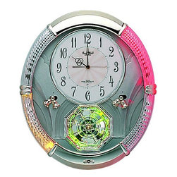"Rhythm Clocks - 17"" x 14"" Amazing Carina Musical Wall Clock - Fascinate your guests with a push of a button! Imagine watching your friend's amazement when they see your new Musical Motion Clock.This luminous clock will captivate any audience with its hourly multi-colored light show that is synchronized with one of 16 melodies. This clock has a consistentlyspinning wheel that holds four enchanting Swarovski crystals, while the two sets of bells swing in a perpetual motion. Clock is battery quartz operated."