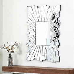 Larisa Rectangle Wall Mirror - 36W x 36H in. - The Larisa Rectangle Wall Mirror – 36W x 36H in. is an elegant modern mirror inspired by the rich tradition of Venetian glassmaking. Crafted from glass and wood in a rich silver finish, this striking rectangular wall accent features a dramatic sunburst border of reflective glass rays.About AbbysonBased in California, Abbyson has been America's leading home lifestyle furnishings brand since 1989. Following a mission that aims to combine style, function, affordability, sustainability and diversity into all their products, Abbyson creates classic and transitional designs that let their customers regain the control in the environments that they call home. With operations in Italy, China, and Germany, Abbyson focuses on using the finest materials, craftsmen, and techniques, from their classic leather furniture sets to organic, hand-knotted Tibetan rugs. Abbyson recently partnered with the Sustainable Furnishings Council as part of their effort to find new ways to bring sustainable practices to home furnishings marketplace. Through their green initiatives and everyday design and construction practices, Abbyson keeps striving to meet their customer's lifestyle needs, and revitalize their day-to-day routines.