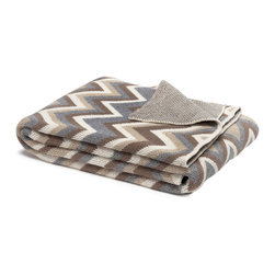 in2green - Eco Zigzag Throw - You'll want to turn this soft knit blanket into a sweater so you never have to take it off. Snuggling with a cozy throw always feels good, but with this retro pattern and distinctive color combination, now it looks good, too.