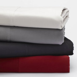 Coyuchi Organic Cotton Sateen King Flat Sheet Pewter - Lustrous on one side, slightly matte on the other, our organic cotton sateen is loomed to a 300-thread count in a buttery twill weave that resists wrinkling. An elegant 7 attached hem finishes the flat sheet and pillowcases, while the fitted sheet has a deep 15 pocket and full elastic for an easy fit on plush mattresses. All pillowcases come in a set of 2.Available colors: Ivory, White, Pewter, Mustard, Mid-Gray.Sateen flat Sheet dimensions: Twin- 66x106, Full / Queen- 90x106, King- 108x106.Sateen fitted sheet dimensions: Twin- 39x75x15, Full- 54x75x15, Queen- 60x80x15, King 78x80x15. Sateen pillowcase dimensions: Standard / Queen- 20x32, King- 20x40, Standard Envelope- 20x26. Care: All of our cotton & linen products are machine washable. We recommend using warm water and non-phosphate soap in the washing cycle, with a cool, tumble or line dry. The use of bleaching agents may diminish the brilliance and depth of the colors, so we recommend not using any whiteners.