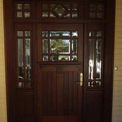 Unique front door - Phirst and Lassing front entry door with sidelights and transom stained in a chocolate brown color.  Made in Hershey, PA
