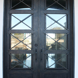 Contemporary Iron Door - Santa Claudia Design Single Wrought Iron Door with Eyebrow Top, handcrafted and perfectly welded details.