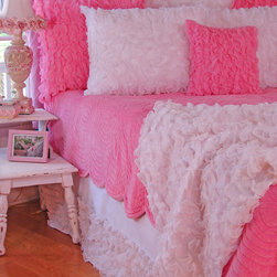 Pink Velvet Quilt - Your little girl loooooves pink and you're determined to give her pink. Well this velvet bedding will do it. With a quilt, skirt, pillow, and throw in varying shades of that bubble gum hue, your daughter will be delighted to go to bed on time, thank you very much.