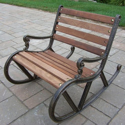 Oakland Living - Mini Garden Rocker - Lightweight. Crisp and stylish traditional lattice pattern and scroll work. Metal hardware. Fade, chip and crack resistant. Warranty: One year limited. Made from durable cast iron and wood. Antique bronze hardened powder coat finish. Minimal assembly required. 15.5 in. L x 20.5 in. W x 28 in. H (31 lbs.)The Oakland Mississippi Collection combines southern style and modern designs giving you a rich addition to any outdoor setting. This rocker will be beautiful addition to your patio, balcony or outdoor entertainment area. Our rocker are perfect for any small space or to accent larger space. We recommend that products be covered to protect them when not in use. To preserve the beauty and finish of the metal products, we recommend applying epoxy clear coat once year. However, because of the nature of iron it will eventually rust when exposed to the elements.
