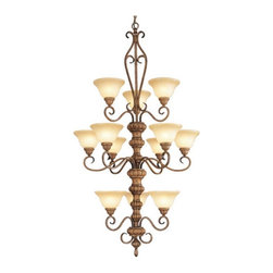 Livex Lighting - Livex Bistro 8298-57 Chandelier - Venetian Patina - 31W in. Multicolor - 8298-57 - Shop for Chandeliers from Hayneedle.com! No other lighting fixture adds more refined charm and upscale appeal to your foyer or formal dining space like the Livex Bistro 8298-57 Chandelier - Venetian Patina - 31W in. Accented with elegant scrolls this handsome 3-tier chandelier reinvents classic design elements to create a piece of lighting that will work its magic equally well in both formal and casual settings. The warm Venetian patina finish plays up the appeal of the art glass shades while twelve 60-watt medium base bulbs (not included) offer warm ambient light for working or relaxing by. The epitome of traditional aesthetics and timeless allure this 31-inch fixture comes with 72 inches of chain and 180 inches of wire for installation. Professional installation is recommended.About Livex LightingLivex Lighting is a manufacturer and distributor of decorative residential lighting. The company was founded in 1993 and is now headquartered in a 150 000-square-foot facility in Morristown New Jersey. Livex Lighting currently offers over 2 500 products ranging from lighting fixtures for indoor and outdoor applications to lampshades chandelier shades ceiling medallions and accent furniture. The goal of Livex Lighting is to provide the highest-quality product at the most affordable price. We are constantly responding to the ever-changing needs styles and fashions of the lighting industry while always maintaining the highest standards of quality.