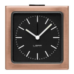 LEFF Amsterdam - Block Alarm Clock Index Dial by LEFF Amsterdam - Simplicity and strength combined in one pretty, petite package. The LEFF Amsterdam Block Alarm Clock Index Dial Combines a sleek square stainless steel case (brushed or copper-plated) with a simple Index-style face. After dark, you can continue to tell the time, with glowing fluorescent hands and the option to illuminate the entire face by pressing the snooze button. Less of the same, more of the different. That is the philosophy behind the modern clock designs created by LEFF Amsterdam. Founded by Arno Ruijzenaars and based in The Netherlands, LEFF reimagines the form and function of classic timepieces to tell time in new and bold ways. Once you have one of their clocks in your home, you'll definitely see how LEFF is more.