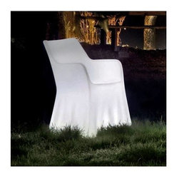 Domitalia - Phantom RGB-LED Illuminated Armchair by Domitalia - An outdoor chair of haunting beauty. The Domitalia Phantom RGB-LED Illuminated Armchair resembles a chair draped in fabric but is, in fact, made out of translucent roto-molded polyethylene. An internal LED array changes colors and creates various lighting effects via remote control. Includes a rechargeable battery. Designed by Orlandini & Radice. Domitalia prides itself--and its line of contemporary furniture--on being 100% Italian. All Domitalia furniture is designed and made in Italy. In-house production of their indoor and outdoor furniture designs allows Domitalia to experiment with innovative materials and processes and keep a tight rein on quality control. The resulting pieces are modern, comfortable and sensual in form, suitable for a range of residential and contract settings.