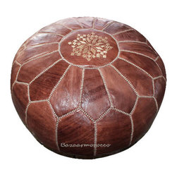 "MOROCCAN LEATHER POUF BROWN - Soothing and sophisticated, the Brown Moroccan Leather Pouf is a fun way to spruce up a room with a touch of shine and sparkle. Hand-stitched Moroccan leather poufs make a great ottoman/foot stool. Little ones enjoy them as a seat that's just their size. Enjoy the versatility and color of this classic decor accessory in your home. Size : 20"" in Diameter, 12"" In Height."