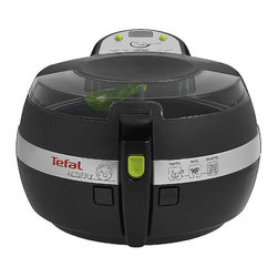 """Frontgate - T-fal Actifry Healthy Fryer - Patented heat-pulsed system and stirring paddle ensure food is evenly cooked, achieving delicious results every time. Cool-touch body for safety. The automatic lid opens at a push of a button for your convenience, and can be opened during cooking to add ingredients or taste the food. Enclosed ceramic non-stick cooking pan is PTFE- and PFOA-free. Removable pan, lid, paddle, and tablespoon are all dishwasher-safe. Hearing the words """"low fat"""" and """"deep fryer"""" in the same sentence may seem paradoxical, but not with the T-FAL ActiFry Healthy Fryer. Prepare hundreds of delicious dishes with 1 tablespoon of oil or less – french fries, stir frys, vegetables, seafood, desserts, and so much more. Simply insert your ingredients, set the timer, turn on, and let the ActiFry's patented cooking technology do the rest. Healthy is good, but delicious AND healthy is even better.  .  .  .  .  . Includes recipe book with over 30 tasty dishes, including recipes developed by nutritionist and FoodNetwork personality Ellie Krieger . No pre-heating required ."""