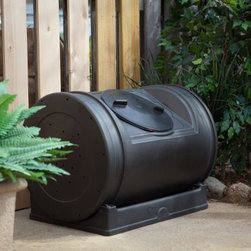 Good Ideas 52 Gallon Compost Wizard Jr. Recycled Plastic Compost Tumbler - Black - We want to make it easy for you to do your part in improving our environment. That's why we're offering the Good Ideas 52 Gallon Compost Wizard Jr. Recycled Plastic Compost Tumbler. A smaller easier to move version of its popular counterpart this composter eliminates the need for strenuous churning. All you have to do is rotate the drum on its stand to quickly and easily mix your compost materials. Glide posts on the base allow the drum to rotate freely while keeping it in position and recessed handles on the sides provide gripping points for easy turning. Turn it about once a week to keep oxygen nutrients micro-organisms and moisture evenly distributed throughout the developing batch. Within just weeks of accruing garden and kitchen waste this compost bin will transform your scraps into valuable organic material. This innovative compost bin is made of molded recycled polyethylene plastic and holds up to 7 cubic feet of material. The black color of the bin absorbs heat which facilitates faster composting. The low-to-the-ground design and wide twist-on lid allows you to load and unload material easily. The air vents circulate air within the batch to accelerate rapid composting. The rotating drum can be removed from its base and rolled to any location for filling or dispensing. The compost tumbler arrives fully assembled and is backed by a one-year manufacturing defect warranty. Additional Features: Twist-off lid for easy access and security Air vents make essential ventilation Is easily rolled for filling or dispensing No assembly is required Base and tumbler included About Good Ideas Inc.Based in Lake City Penn. Good Ideas Inc. was founded in 2001 and has been promoting green living ever since. Many of their innovative products have been featured in magazines newspapers TV shows and news stories. Good Ideas' products focus on sustainability and are developed from practical common-sens