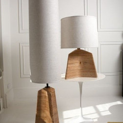 Jonathan Adler Reynolds Floor Lamp - This floor lamp is a bit of an optical illusion; it takes the components of a table lamp, plays with scale and stretches it so that it works on the floor. They didn't start playing there - the base is made of plywood that his been stacked to show off the striations; it looks a bit like a driftwood lamp from a distance.