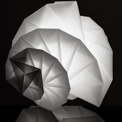 """Artemide - Artemide Mendori Table Lamp - Issey Miyake's unique folding technology creates both statue forms as well as solidity. This structure is made of recycled material,  with an additional surface treatment allows these shades to perfectly keep..     The Mendori Table Light is composed of a recycled fabric shade and an internal structure composed of a diffuser tube and LED chip. The LED light source is masde of optics that project along the diffusing PMMA tube. A white powder painted die-cast aluminum cylinder acts as heat sync for the LED chip. This light features a canopy in white opal polycarbonate with laser etched Artemide and IN-EI logo0s.  The frame is fitted with a magnetic component to fit to the diffuser. Ships with 4 feet of transparent wire with dimmer.     Manufacturer: Artemide   Designer: Issey Miyake's    Made in: Italy     Dimensions:   Diameter: 19.69"""" ( 50 cm ) X Width: 18.94"""" ( 48 cm ); 17.31"""" ( 44 cm) max height     Lamping:    1 X 10W (medium base) dimmable LED module (not included)     Material: Fabric, Cloth, Polycarbonate, Polymer"""