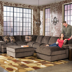 Sectionals at FurnitureCart - Create the perfect comfortable seating space in your home with the flexible and functional Truscotti - Cafe Sectional from Signature Design by Ashley Furniture.