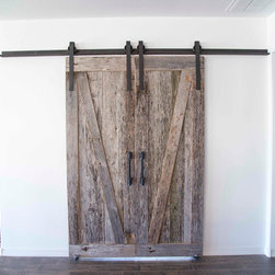 Sliding Barn Door - Bi-Part Z's Reclaimed Tobacco Barn Rough Grey/Smooth Brown - Very unique from your typical sliding barn doors.  These bi-part sliding barn doors were made with our Reclaimed Tobacco Barn Grey barn wood.  We smoothed the lumber 50% then gave it a dirty brush all before we topped it off with a lacquer.  This provides so much character preserving the beautiful and natural  silver patina on the front, and an exciting and elegant look on the backside.