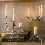 Antler Candlesticks and Pillar Holders - These candlesticks are cast in recycled aluminum from real antlers then burnished to a high shine.  The Pillar style uses downward-facing antler points, raising the candle above the tabletop.  The multi taper candleabra holds four candles.