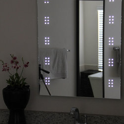 LED Illuminated Mirror - Lighted Image presents this modern and stylish illuminated bathroom mirror with LEDs clustered down each side. With a degree of sophistication, this LED bathroom mirror features a sensor switch that allows you to illuminate the LED mirror with the swipe of a hand and a de-mister to ensure your mirror stays crystal clear.