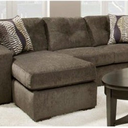 Chelsea Home Rockland Sofa with Chaise - Hematite Gray - Like the most gorgeous form of iron oxide, but much softer, the Chelsea Home Rockland Sofa with Chaise - Hematite Gray has a natural charm perfect for your home. This comfortable and stylish sofa has plenty of room for everyone to stretch out.About Chelsea Home FurnitureProviding home elegance in upholstery products such as recliners, stationary upholstery, leather, and accent furniture including chairs, chaises, and benches is the most important part of Chelsea Home Furniture's operations. Bringing high quality, classic and traditional designs that remain fresh for generations to customers' homes is no burden, but a love for hospitality and home beauty. The majority of Chelsea Home Furniture's products are made in the USA, while all are sought after throughout the industry and will remain a staple in home furnishings.