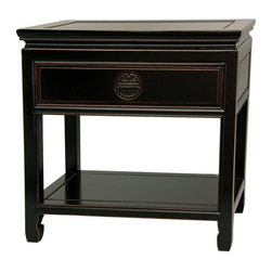 "Oriental Furniture - Rosewood Bedside Table - Antique Black - An elegantly finished, distressed black lacquer nightstand or end table, hand crafted from fine quality kiln dried Rosewood. A beautiful and practical design, with an easily accessed top drawer and open bottom shelf area, great for storing bedside reading. Designed with the classic Ming edged floating panel table top, to tolerate expansion from changes in moisture content in the wood. The drawer pull is carved in the shape of a ""Shou"", symbolizing long life."