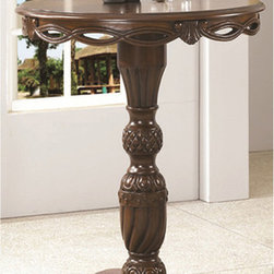 None - 42-inch Pub Table - Bring a sophisticated touch to your home with this pub table. This table stands 42 inches tall,features carved details and boasts a beautiful walnut finish.