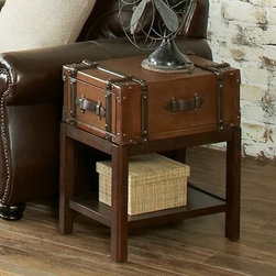Riverside Latitudes Suitcase Chair Side Table - Aged Cognac Wood - Give your modern home a touch of vintage charm with the Riverside Latitudes Suitcase Chair Side Table - Aged Cognac Wood. The chic design of this side table makes it the perfect companion to your furnishings. The aged cognac wood finish beautifully complements the synthetic leather accents for a piece that brings an old look to a new style. The drawer and open shelf below provide handy storage. Assembly required.Notes on Riverside ConstructionAll Riverside domestic furniture is constructed of fine oak, ash, poplar, and pine wood. These wood types are durable and feature beautiful, open grains that make them much preferred among furniture manufacturers. Each piece of wood is first graded for quality, then kiln-dried to remove excess moisture and prevent splitting. The wood is then constructed into a high-quality furniture piece using a combination of hardwood solids and hand-selected veneers. Techniques used on Riverside pieces include dovetail joinery, heavy-duty drawer roller guides, and multi-step finish applications that include hand-sanding and polishing for a deep, lustrous result. All Riverside furniture is given this high-quality treatment to ensure the beauty and durability of your final product.About Riverside FurnitureRiverside has been growing for more than half a century. The company's founder, Herman Udouj, opened the doors to his first factory in 1946, and along with 12 employees, he began making handcrafted furniture for the post-World War II Baby Boom era. Since then, generations of customers have furnished their homes and offices with Riverside's wide range of furniture products. Riverside strives to be trusted for quality products that are an affordable value. It's just that simple.