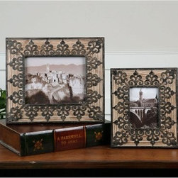 Uttermost Abelardo Photo Frames - Set of 2 - Photos of your European vacation never quite popped like they will in the Uttermost Abelardo Photo Frames - Set of 2. These classically beautiful frames feature an aged fir wood border and unique weathered wrought-iron detailing that surrounds your pictures and draws attention to the middle.About UttermostThe mission of the Uttermost Company is simple: to make great home accessories at reasonable prices. This has been their objective since founding their family-owned business over 30 years ago. Uttermost manufactures mirrors, art, metal wall art, lamps, accessories, clocks, and lighting fixtures in its Rocky Mount, Virginia, factories. They provide quality furnishings throughout the world from their state-of-the-art distribution center located on the West Coast of the United States.
