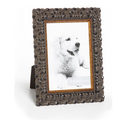 """Origin Crafts - Vintage raven black wood picture frame - Vintage Raven Black Wood Picture Frame Amongst the twenty arrondissements or districts that make up Paris there is a former fortress which stands proud as the focal point of district number one ? the Louvre. A majestic masterpiece where priceless art is encased in classic elegance, founded in the spirit of authentic French tradition. It was here in the Louvre, inspired by its magnificence and contribution to modern culture that Vintage was born. Dimensions (in): Width: 1 1/2, Height: 1 Holds (4""""x6"""", 5""""x7"""", 8""""x10"""") photos. By Roma Moulding - Roma Moulding uses only the highest quality materials. Roma owes it?s renown to exquisite details: meticulous applications of gold and silver leafing, genuine woods, exotic veneers, patinas, superior lacquers and finishes all done by hand. Roma employs time proven techniques to achieve the stunning finishes other manufacturers strive to achieve. Ships within Five Business Days."""