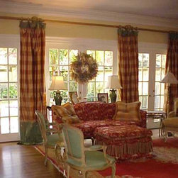 Pamela Foster & Associates, Inc. - These window treatments were also used by the owner's friendly cat as a litter box, so we replace the bottom of them with coordinating fabric.  Actually, I like the idea and have designed others like that on purpose, not because of a beloved kitty!  Photo credit Pamela Foster.