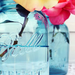 Vintage Blue Mason Jars by Wedding Bee - Blue mason jars make perfect flower vases, and you can usually find them at flea markets and vintage stores. I have an entire collection that gets heavily used around this time of year. They're perfect for elevating that grocery store bouquet.