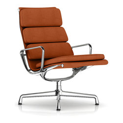 """Herman Miller - Eames Soft Pad Lounge Chair - Swivel Base - Fabric - Designed with serious lounging in mind, this chair was made for a little R & R. The iconic team of Charles and Ray Eames wanted to create a chair just for the home — one that was a quiet departure from those typically found in an office environment. Unlike others in the series, this model has a permanent recline and longer back for a more """"stretched out"""" feel."""