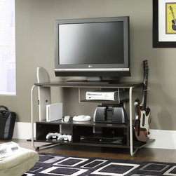 "Sauder - Booster 47"" TV Stand - All purpose TV and gaming stand ideal for playroom or student's room. Features: -White frame.-Holds TVs weighing 70 lbs or less.-Open shelving with cable management.-Side storage.-Frame construction: Steel.-Brown finish.-Booster collection.-Recommended TV Type: Flat.-TV Size Accommodated: 47"".-Finish: Twine/Cocoa Oak.-Powder Coated Finish: No.-Gloss Finish: No.-Material: Engineered wood and metal.-Solid Wood Construction: No.-Distressed: No.-Exterior Shelves: Yes -Number of Exterior Shelves: 5.-Adjustable Exterior Shelves: No..-Drawers: No.-Cabinets: No.-Removable Back Panel: No.-Casters: No.-Accommodates Fireplace: No.-Lighted: No.-Media Player Storage: Yes.-Media Storage: Yes .-Remote Control Included: No.-Weight Capacity: 70 lbs.-Swatch Available: No.-Commercial Use: No.-Collection: Booster.-Recycled Content: No.-Lift Mechanism: No.-Expandable: No.-TV Swivel Base: No.-Integrated Flat Screen Mount: No.-Hardware Material: Metal.-Non-Toxic: Yes.-Product Care: Wipe with a damp cloth.Specifications: -ISTA 3A Certified: Yes.-CARB 2 Certified: Yes.-CARB Certified: Yes.-FSC Certified: Yes.-General Conformity Certified: Yes.-EPP Certified: Yes.Dimensions: -Base must not be larger than 47'' wide.-Overall Height - Top to Bottom: 25.118"".-Overall Width - Side to Side: 46.457"".-Overall Depth - Front to Back: 17.244"".-Drawer: No.-Shelving: Yes.-Cabinet: No.-Legs: Yes.-Overall Product Weight: 53 lbs.Assembly: -Assembly Required: Yes.-Tools Needed: Phillips screwdriver (Allen Wrench included).-Additional Parts Required: No.Warranty: -1 Year warranty.-Product Warranty: 1 Year."
