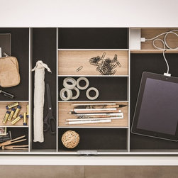 SieMatic Interior Design System - These aluminum inserts by SieMatic in light oak keep drawer interiors organized and aesthetically pleasing. Everything has its place - including a USB charger to keep technology at hand and out of sight until needed.
