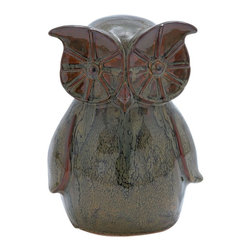 Benzara - Unique Ceramic Owl with Glossy Design and Smooth Texture - Elegantly designed, this 11 in. H Unique Ceramic Owl with Glossy Design and Smooth Texture is sure to enhance the elegance of your home decor. This ceramic designer owl is pleasing in appearance and incorporates an exquisite style. It can enhance the ambience of your living room and give it unique styling. It has a glossy surface and is given a bold personality by highlighting its eyes and enlarging it in a curved droplet. The creative use of imagination and excellent craftsmanship has given it a marvelous appeal. Its versatile details and impressive style enables it to be used anywhere in the house. It is beautifully crafted with mold of ceramic and flaunts smooth edges to create a distinct style that boasts of glamour. This ceramic owl is so attractive that it will leave visitors to your home greatly impressed.