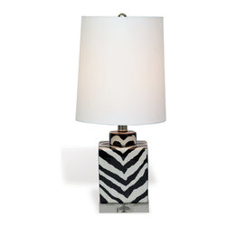 "Kathy Kuo Home - Kenya Modern Black and White Zebra Print Tea Jar Table Lamp- 21""H - When it comes to exotic chic, there's nothing like a monochrome animal print lamp to add a little extra interest.  This small porcelain zebra stripe lamp creates the perfect compliment to a contemporary exotic or even Hollywood Regency inspired space."