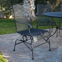 Woodard Stanton Wrought Iron Coil Spring Dining Chair - Set of 2 - Textured Blac - Not only is the Woodard Stanton Mesh Coil Spring Dining Chair - Set of 2 - Textured Black highly functional it also adds plenty of upscale appeal to your patio dining area. Characterized by a simple yet elegant design clean lines and textured black powder-coat finish that goes beautifully with most outdoor settings these chairs will envelop you in comfort all through the meal. The spring base offers a slight rocking feel to further pump up your comfort level. The frame of each piece is purified and dipped into a bath of rust-inhibiting zinc phosphates during the state-of-the-art MetalGuard finishing process. The fully-welded wrought iron frames are then electrostatically coated creating a permanent seal to lock out rust. And since wrought iron furniture is heavier than aluminum it stays put even in the face of strong winds making it a great choice for windier locations. Made by Woodard the leader in outdoor wrought iron furniture this set of two spring dining chairs will make outdoor dining more fun than ever before. About Woodard:For over 140 years Woodard craftsmen have designed and manufactured products loyal to the timeless art of quality furniture construction. Using the age-old art of hand-forming and the latest in high-tech manufacturing Woodard remains committed to creating products that will provide years of enjoyment. Most Woodard furniture is assembled by experienced professionals before being shipped. That means you can enjoy your furniture immediately and with confidence. Together these elements set Woodard furniture apart from all others. When you purchase Woodard you purchase a history of quality and excellence and furniture that will last well into the future.