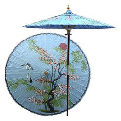 "Oriental-Décor - Asian Splendor (Andaman Blue) - Beautiful and artistic, this outdoor patio umbrella features a juniper tree, which is symbolic of wisdom and protection, with two cranes flying near. Ideal for any outdoor setting, this stunning patio umbrella is excellent for adding a vibrant and colorful touch to any deck or patio.      - 7 foot umbrella pole constructed of rich stained oak hardwood.  - Each umbrella is entirely handcrafted down to the finest detail.  - Oil-treated cotton umbrella shades are all hand-painted by our master artists.  - Dual position shade height allows for full coverage or a better view of the painted shade.  - Waterproof and weatherproof.  - Two-piece pole fastens securely with a polished metal coupling.  - Pole diameter of 1.5"" easily fits into any standard size umbrella base or table.  - Optional umbrella base available - handcrafted from stained oak hardwood."