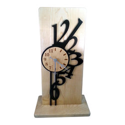 Unique Contemporary Maple Wood Mantel Clock with Abstract Numbers - This clock is made of maple which is has a natural finish to protect it. The abstract numbers that look like they are falling around the clock are ebonized black. The face is engraved into the wood.