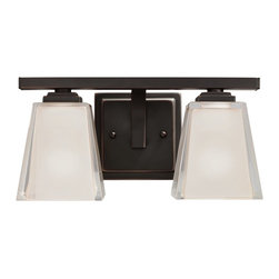 """Kichler - Metro Kool Bronze 12 1/2"""" Wide Bath Light Fixture - Add a soothing element to your bath decor with this stylish bath bar light from Kichler. The crisp, contemporary look of the chunky glass is balanced with the classic Old Bronze finish. The angled and stylized glass is distinctive in that the exterior layer is polished clear glass and the inside surface is etched light umber. The layered effect is impressive and unique. Install the glass up or down, depending on your needs."""