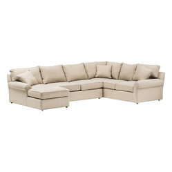 Craig Sectional - Outfit your room with the ultimate in style and comfort with this chic sectional. This sofa's rolled arms and generous cushions are both elegant and relaxing to sit upon. With this sofa taking up one corner of your sitting room with such sophistication, everyone can rest easy.