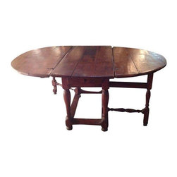 "Pre-owned Spanish Gate Leg Table - They sure don't make 'em like they used to. True craftsmanship is evident in this beautiful Spanish style gate leg table. The wood features a patina that only age can create. The beautiful woodworking shows in the legs, carved details and gate leg mechanism.     The top is adjustable from 68"" down to 22""."